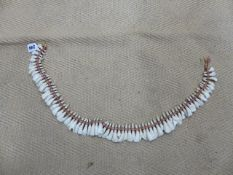 A TRIBAL NECKLACE OF BOVINE? TEETH.