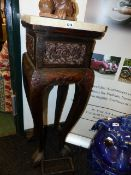 A PAIR OF CARVED CHINESE SQUARE MARBLE TOP STANDS DECORATED WITH RELIEF PANELS ON CABRIOLE LEGS