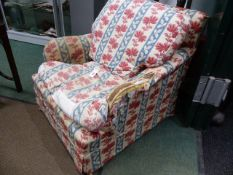 A HOWARD STYLE ARMCHAIR WITH FEATHER FILLED LOOSE CUSHIONS.