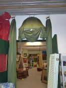 A BESPOKE DOME TOP ENTRANCE WAY OR BED HANGING IN RIBBED LINED GREEN FABRIC.