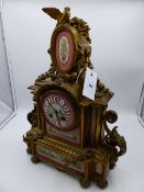 A VICTORIAN GILT METAL CASED MANTLE CLOCK WITH PORCELAIN HANDPAINTED INSET PANELS AND DIAL. 8-DAY