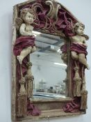 A CAST CHERUB FRAMED MIRROR WITH PAINTED RELIEF DECORATION