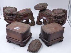 A NEAR PAIR OF CHINESE CARVED HARDWOOD BOXES ON CONFORMING STANDS TOGETHER WITH A PAIR OF LACQUER