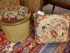 A VICTORIAN GILTWOOD NEEDLEPOINT COVERED OTTOMAN WITH A FLORAL CUSHION COVER OF SIMILAR DATE.