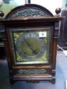 A LATE VICTORIAN OAK CASED MANTLE CLOCK WITH WINTERHALDER & HOFFMEIR MOVEMENT. H.37cms.