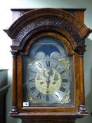AN 18th.C.DUTCH WALNUT CASED LONGCASE CLOCK WITH FRET PANEL HOOD OVER SLENDER DOOR WITH BULLSEYE
