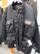 A WEISE MOTORCYCLE JACKET WITH ZIP IN LINER, SIZE M.