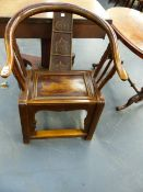 AN INTERESTING CHINESE CARVED TUB FORM ARMCHAIR WITH FIGURAL BACKSPLAT AND SQUARE STRETCHERED LEGS.