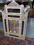 AN EASTERN MOTHER OF PEARL INLAID MIRROR WITH SHAPED AND PIERCED CREST AND SIMILAR SIDE PANELS. H.