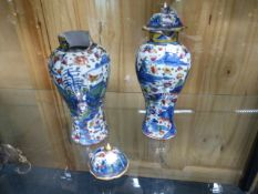 A NEAR PAIR OF CHINESE BLUE AND WHITE COVERED VASES OF LOBED FORM WITH CLOBBERED FAMILLE ROSE
