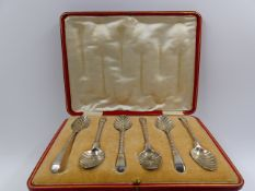 A GEORGE II SILVER CASTER DATED 1732, TOGETHER WITH A GEORGE III CREAM JUG DATED 1780 AND TWO