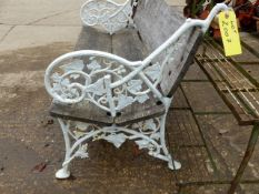 AN ANTIQUE GARDEN BENCH WITH CAST IRON ENDS OF ENTWINED IVY FORM.