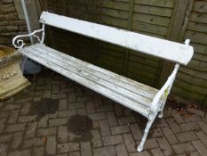 AN ANTIQUE GARDEN BENCH WITH CAST IRON ENDS.