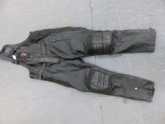 A PAIR OF SKIN MOTORCYCLE LEATHER BIB TROUSERS, SIZE XL.