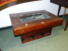 A JAPANESE ELM HIBACHI WITH THREE SMALL DRAWERS TO BASE AND A METAL LINER. H.38 x W.80cms.