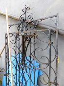 A PAIR OF WROUGHT IRON DRIVEWAY GATES.