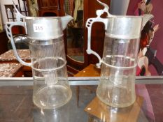 A NEAR PAIR OF WMF LARGE LEMONADE JUGS WITH ICE CAPSULE INSERT AND SILVER PLATED MOUNTS.