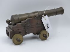 A 19th.C.BRONZE MODEL CANNON ON HAND MADE STEPPED CARRIAGE WITH ADJUSTABLE ELEVATION.