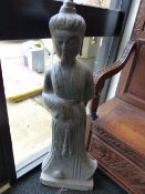A CHINESE CARVED STONE GARDEN FIGURE OF A STANDING DEITY. H.110cms.