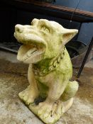 A PAIR OF WELL CAST WEATHERED DOG FORM GATEPOST FINIALS.