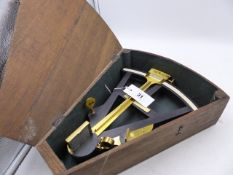 A 19th.C.EBONY AND BRASS OCTANT WITH IVORY SCALE CONTAINED IN AN OAK SHAPED CASE.