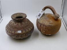 TWO ANCIENT MIDDLE EASTERN POTTERY VESSELS WITH GEOMETRIC DECORATION.
