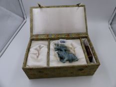 A CHINESE JADE MODEL OF AN ELEPHANT AND SHI SHI WITH PLINTH. H.10cms. (boxed)