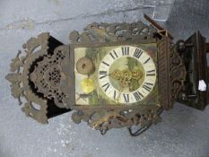 A DUTCH STAART WALL CLOCK WITH PAINTED DIAL AND PIERCED METAL DECORATION. H.68cms.
