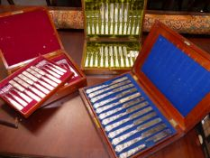 A CASED SET OF 12 19th CENTURY SILVER PLATED DESSERT KNIVES AND FORKS WITH MOTHER OF PEARL HANDLES