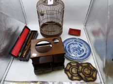 AN ORIENTAL BIRD CAGE TOGETHER WITH A CARVED HARDWOOD SMALL CARRYING STAND FITTED WITH DRAWERS,