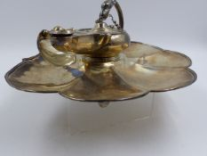 A SILVER HALLMARKED VICTORIAN INKSTAND IN THE FORM OF A LAMP ON A LILY LEAF BASE DATED 1860, LONDON.