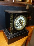 A VICTORIAN BLACK SLATE MANTLE CLOCK WITH VISIBLE ESCAPEMENT. H.26cms.