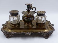 A VICTORIAN TWO BOTTLE INKSTAND WITH A CENTRAL TAPER STICK INCLUDING SNUFFER. DATED LONDON 1858.