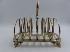 A VICTORIAN SILVER HALLMARKED TOAST RACK, DATED 1844. APPROXIMATE MEASUREMENTS 17.5cms X 12.2cms.