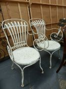 A PAIR OF FRANCOIS CARRE SPRUNG BACK WROUGHT IRON GARDEN OR CAFE CHAIRS.