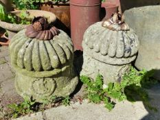 A PAIR OF ANTIQUE CARVED STONE FINIALS WITH IRON LEAF KNOPS.