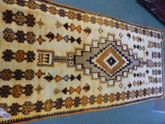 A NORTH AFRICAN TRIBAL RUG. 264 x 126cms.