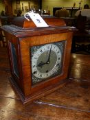 A 20th.C.GEORGIAN STYLE BRACKET CLOCK WITH 3-TRAIN CHIMING MOVEMENT AND BRASS DIAL SIGNED GOLDSMITHS