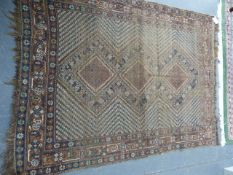 AN ANTIQUE PERSIAN SHIRAZ RUG. 184 x 144cms AND TWO SMALLER EXAMPLES. (3)