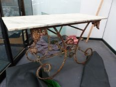 AN ANTIQUE FRENCH WROUGHT IRON BAKERS TABLE WITH MARBLE TOP. 137 x 61 x H.80cms.