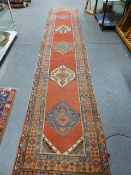 AN ANTIQUE PERSIAN TRIBAL RUNNER. 530 x 100cms.