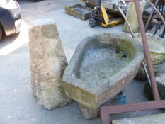 A HORSESHOE FORM STONE TROUGH, ANOTHER TROUGH AND A STADDLE STONE WITH TOP.
