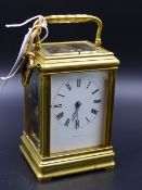 AN EARLY 20th.C.CARRIAGE CLOCK WITH WHITE ENAMEL DIAL SIGNED PLEISTER - GENEVA.