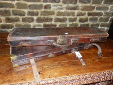 """A BRASS MOUNTED OAK AND LEATHER GUN CASE REFITTED TO ACCOMMODATE 30"""" BARRELS TOGETHER WITH A LEATHER"""
