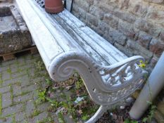 A 19th.C.GARDEN BENCH WITH CAST IRON SCROLL SUPPORTS. W.196cms.