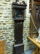 """AN OAK CASED 8-DAY LONGCASE CLOCK WITH 12"""" BRASS DIAL AND SILVERED CHAPTER RING SIGNED ISAAC HADMEN,"""