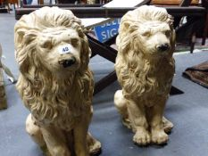 A PAIR OF OLD COMPOSITE STONE FIGURES OF SEATED LIONS, LATER PAINTED. H.54cms.