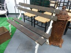 AN ANTIQUE SMALL GARDEN BENCH WITH BRANCH FORM CAST IRON ENDS. W.119cms.