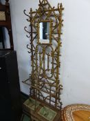A 19th.C.CAST IRON HALL STAND OF FAUX BAMBOO DESIGN IN THE MANNER OF COALBROOKDALE.