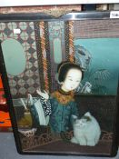 A CHINESE REVERSE PAINTING ON GLASS OF A YOUNG WOMAN WITH HER CAT IN A CARVED HARDWOOD FRAME..